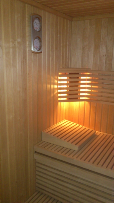 Set-up of a little bio-sauna (Almese - Torino - Italy) Lamp and bench detail
